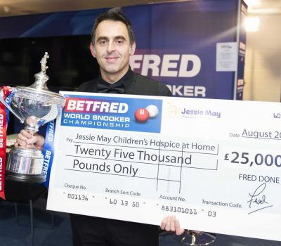 Ronnie O'Sullivan accepts a £25,000 cheque on behalf of Jessie May
